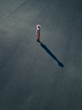 Magdalena Russocka retro woman standing on sunny pavement from above