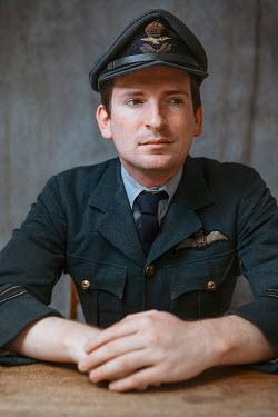 Shelley Richmond WARTIME PILOT IN UNIFORM SITTING INDOORS