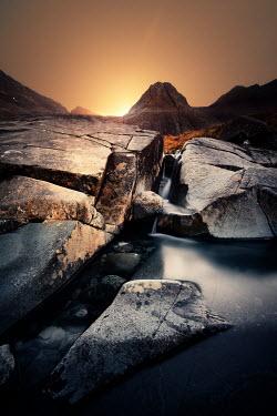 David Keochkerian ROCKS BY WATER AT SUNSET