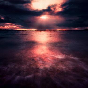 David Keochkerian MISTY SEA AT SUNSET WITH STORMY SKY