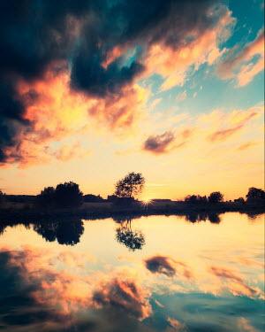 David Keochkerian CLOUDS AT SUNSET REFLECTED IN LAKE