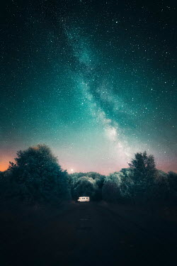 David Keochkerian CAMPER VAN ON COUNTRY ROAD WITH STARRY SKY