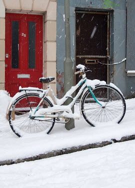 Lesley Aggar BICYCLE BY LAMPPOST IN SNOWY STREET