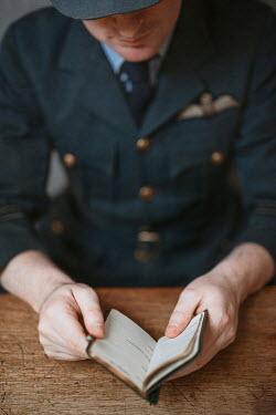 Shelley Richmond WARTIME PILOT IN UNIFORM SITTING READING DIARY