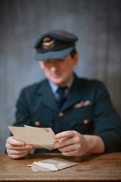 Shelley Richmond WARTIME PILOT SITTING READING LETTER