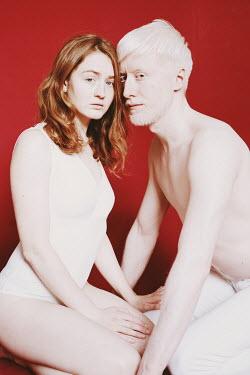 Elena Tyagunova CLOSE COUPLE IN WHITE KNEELING ON FLOOR