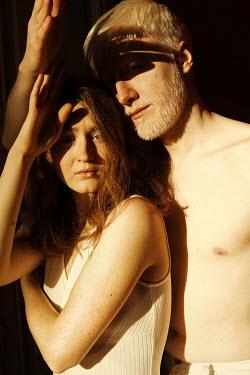 Elena Tyagunova SERIOUS COUPLE STANDING IN SUNLIGHT