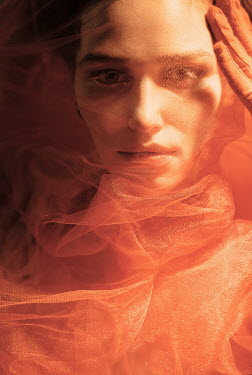 Elena Tyagunova FEMALE FACE COVERED WITH ORANGE CHIFFON