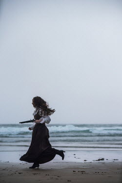 Marie Carr HISTORICAL WOMAN RUNNING ON BEACH WITH PISTOL