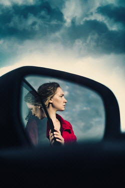 Magdalena Russocka close up of modern woman reflecting in car wing mirror