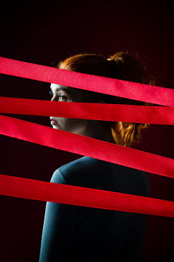 Natasza Fiedotjew picture of girl superimposed with red ribbon