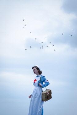 Natasza Fiedotjew wartime nurse standing with flock of birds above