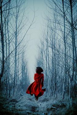 Natasza Fiedotjew brunette in red coat running among trees