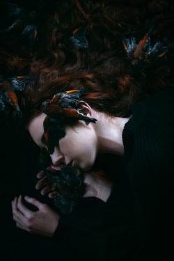 Natasza Fiedotjew sleeping woman covered with dead birds