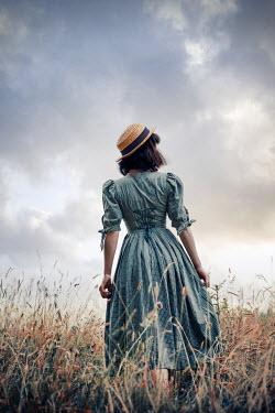 Natasza Fiedotjew woman wearing dress and hat in field in summer