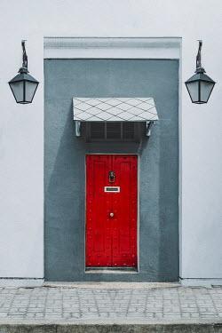 Evelina Kremsdorf RED DOOR IN GREY BUILDING WITH LANTERNS