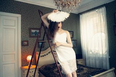 Elena Tyagunova WOMAN WITH FAN ON LADDER IN BEDROOM