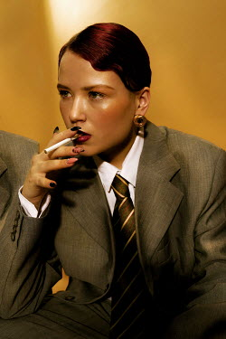 Elena Tyagunova WOMAN WITH RED HAIR IN SUIT SMOKING CIGARETTE