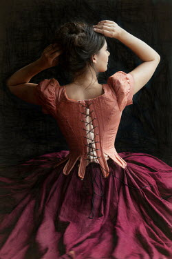 Lee Avison brunette victorian woman wearing a pink corset
