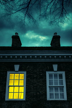 Magdalena Russocka old townhouse with light in window at night