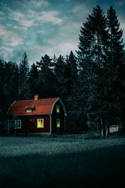 Magdalena Russocka swedish cottage house with lights in windows at night