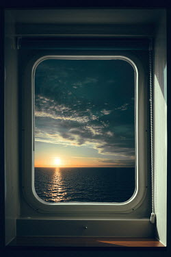 Magdalena Russocka window of cruise boat with view of sunset from inside