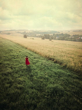 Magdalena Russocka young woman walking in field from above