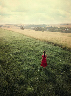 Magdalena Russocka young woman standing in field from above