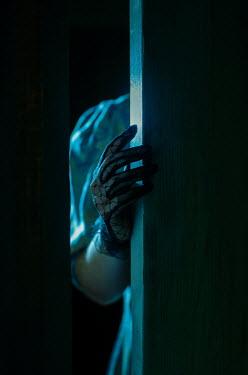 Svitozar Bilorusov FEMALE HAND WITH LACY GLOVE TOUCHING DOOR