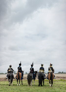 Stephen Mulcahey GROUP OF HISTORICAL CAVALRYMEN ON HORSEBACK