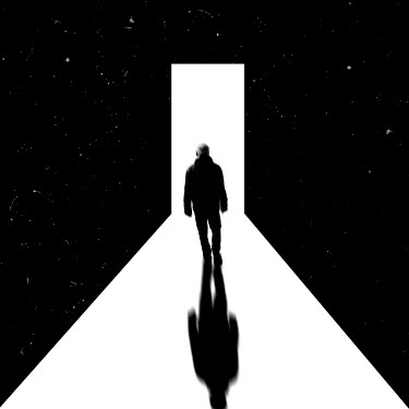 Dirk Wustenhagen Man walking towards light shining through a door