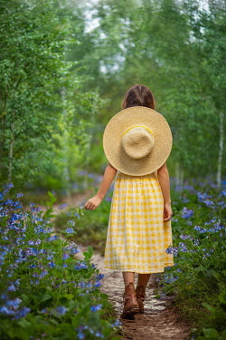 Lilia Alvarado Girl with straw hat and yellow dress in forest