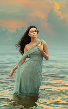 Lilia Alvarado Young woman with blue dress in sea