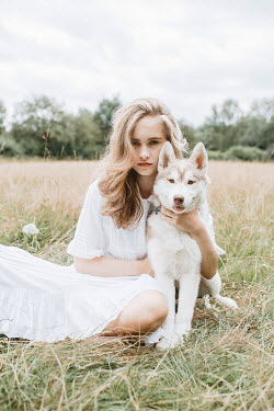 Shelley Richmond Young woman with husky puppy