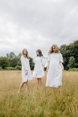 Shelley Richmond Young women in white dresses in field