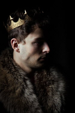 Magdalena Russocka young man wearing fur and golden crown