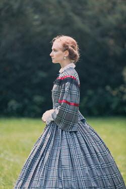 Magdalena Russocka victorian woman standing in garden