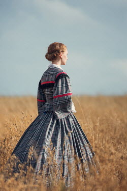 Magdalena Russocka victorian woman standing in field