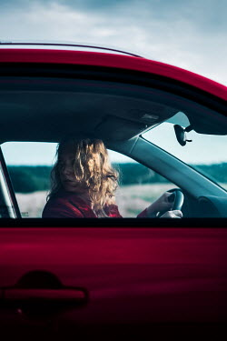 Magdalena Russocka young woman sitting in car