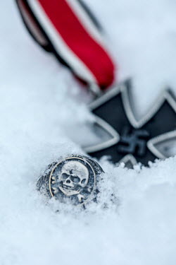 Stephen Mulcahey Nazi iron cross medal and skull ring in snow