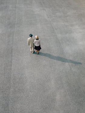Magdalena Russocka retro couple walking on pavement from above