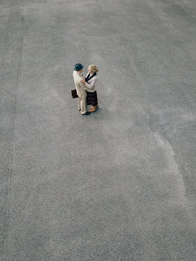 Magdalena Russocka retro couple embracing on pavement from above