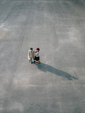 Magdalena Russocka retro couple standing on pavement from above