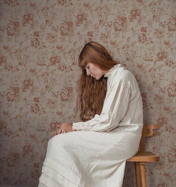 Felicia Simion SAD WOMAN IN NIGHTDRESS SITTING INDOORS