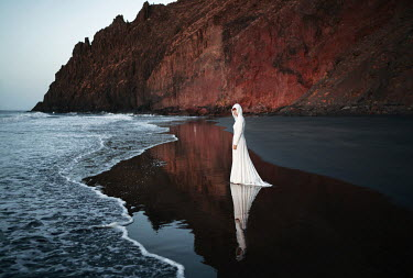 Felicia Simion WOMAN IN WHITE ON BEACH WITH CLIFFS