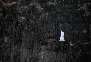 Felicia Simion WOMAN IN WHITE STANDING ON CLIFFS