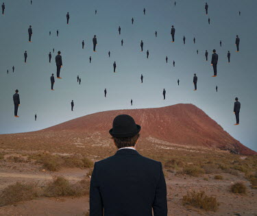 Felicia Simion MAN IN HAT WITH FLOATING MEN IN DESERT