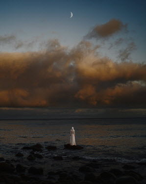 Felicia Simion WOMAN IN WHITE WATCHING SEA AT DUSK