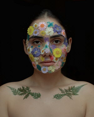 Felicia Simion SAD FEMALE FACE COVERED IN FLOWERS