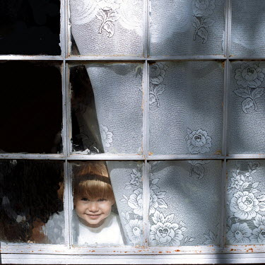 Felicia Simion HAPPY LITTLE GIRL INDOORS WATCHING AT WINDOW